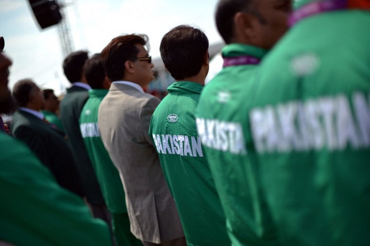 Pakistani athletes listen to the Olympic anthem during the Flag Raising Ceremony held at the Olympic village in London on July 25, 2012, two days before the start of the London 2012 Olympic Games.2012. (Saeed Khan/AFP/Getty Images)