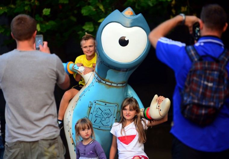 Children pose with the Olympic mascot Wenlock on July 25, 2012 in London, two days before the opening ceremony of the London 2012 Olympic Games. (Emmanuel Dunand/AFP/Getty Images)