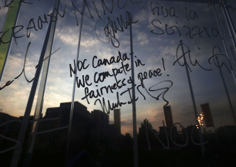 The writing on the Truce Wall left by Chef De Mission of Canada Mark Tewksbury is seen during a Welcome Ceremony at the Olympic Park in London July 25, 2012. (Mark Blinch/Reuters)