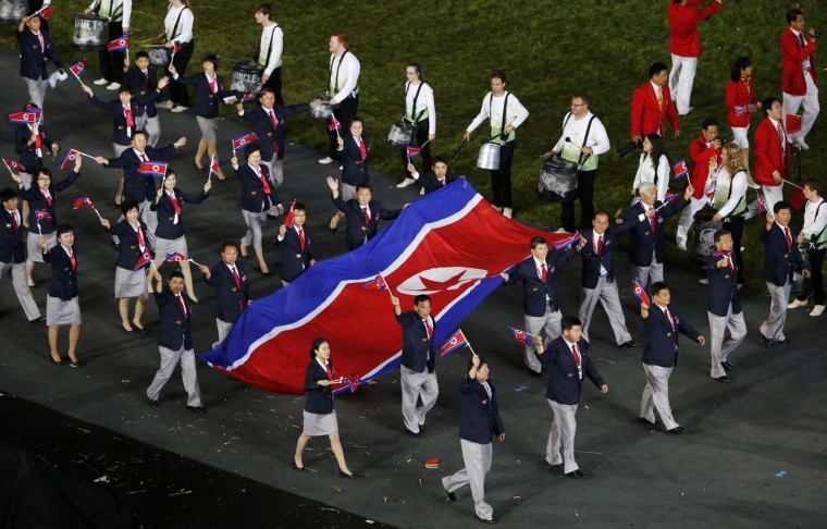 Members of North Korea's contingent hold a giant national flag as they take part in the athletes parade during the opening ceremony of the London 2012 Olympic Games at the Olympic Stadium July 27, 2012. (David Gray/Reuters)