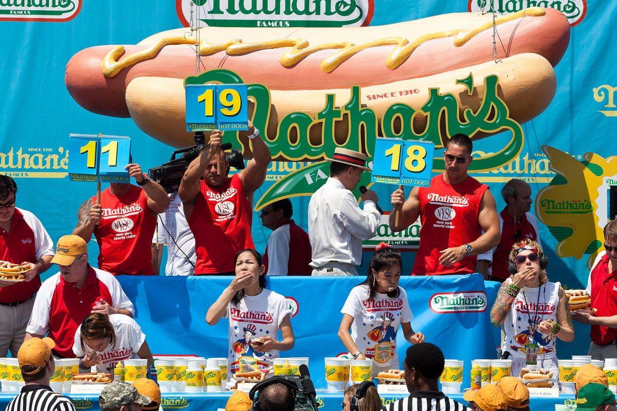Competitive eater Sonya Thomas, second from left on the bottom row, competes in the Nathan's Famous International Hot Dog Eating Contest at Coney Island in the Brooklyn borough of New York City. (Andrew Burton/Getty Images)