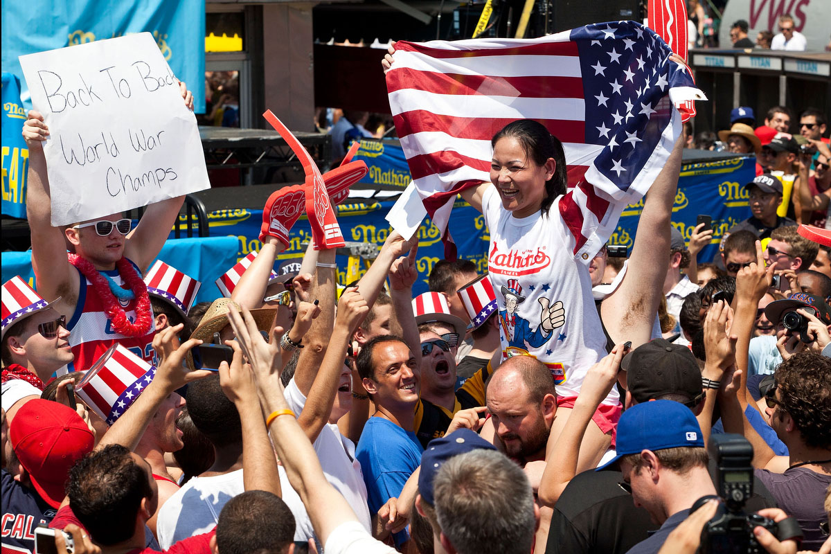 Competitive eater Sonya Thomas is carried through the crowd after winning the women's division of the Nathan's Famous International Hot Dog Eating Contest at Coney Island in the Brooklyn borough of New York City. Thomas won the women's division by successfully eating 45 hot dogs in 10 minutes, setting a new world record. (Andrew Burton/Getty Images)