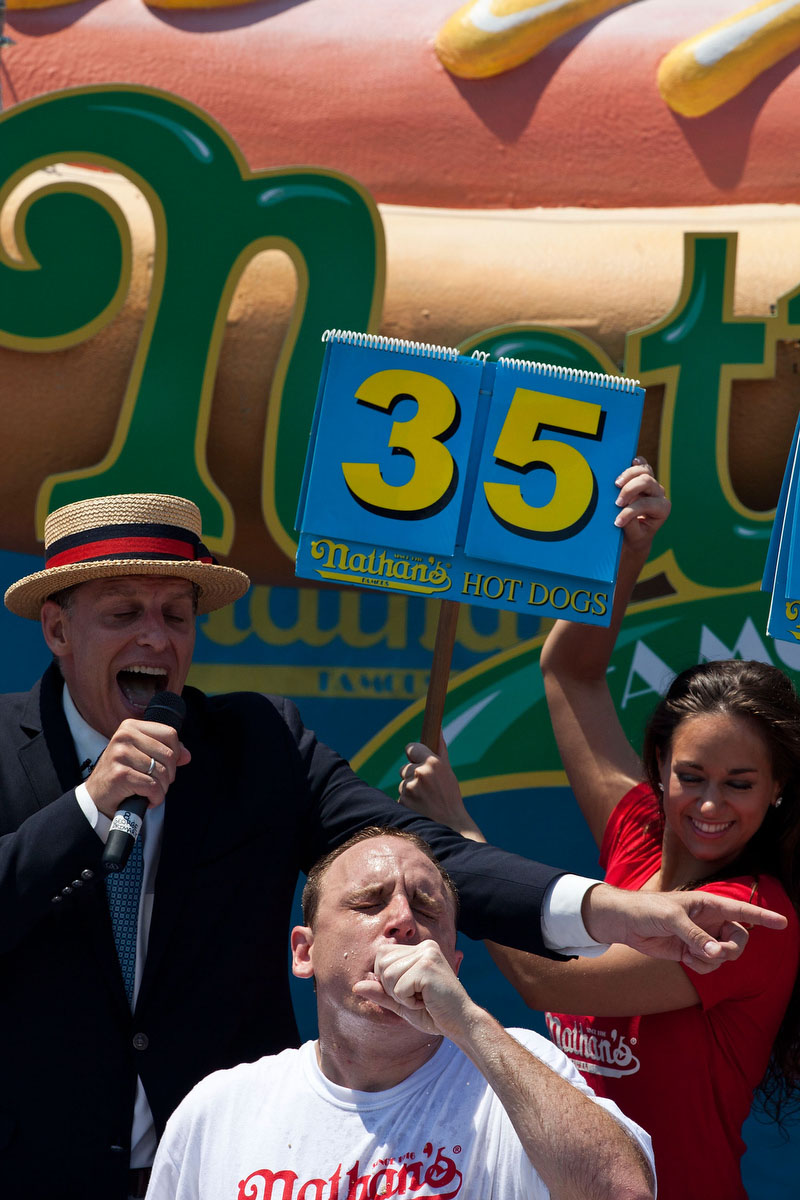 Competitive eater Joey Chestnut competes in the Nathan's Famous International Hot Dog Eating Contest at Coney Island. Chestnut won the men's division by successfully tying his own world record. (Andrew Burton/Getty Images)