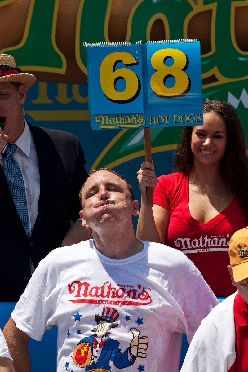 Competitive eater Joey Chestnut rests after winning the Nathan's Famous International Hot Dog Eating Contest at Coney Island in the Brooklyn borough of New York City. Chestnut won the men's division by successfully tying his own world record by eating 68 hot dogs in 10 minutes; he has now won the competition six years in a row. (Andrew Burton/Getty Images)
