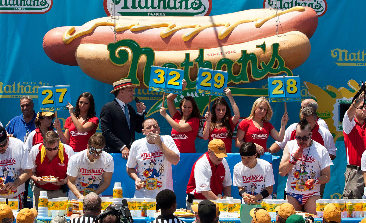 Competitive eaters compete in the men's division of the Nathan's Famous International Hot Dog Eating Contest at Coney Island on July 4, 2012 in the Brooklyn borough of New York City. (Andrew Burton/Getty Images)