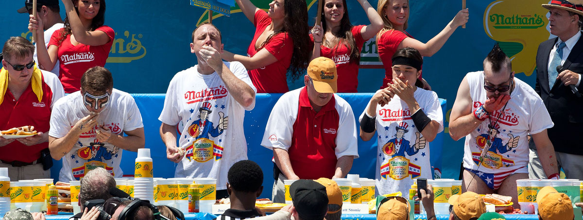 Competitive eaters compete in the men's division of the Nathan's Famous International Hot Dog Eating Contest at Coney Island(Andrew Burton/Getty Images)