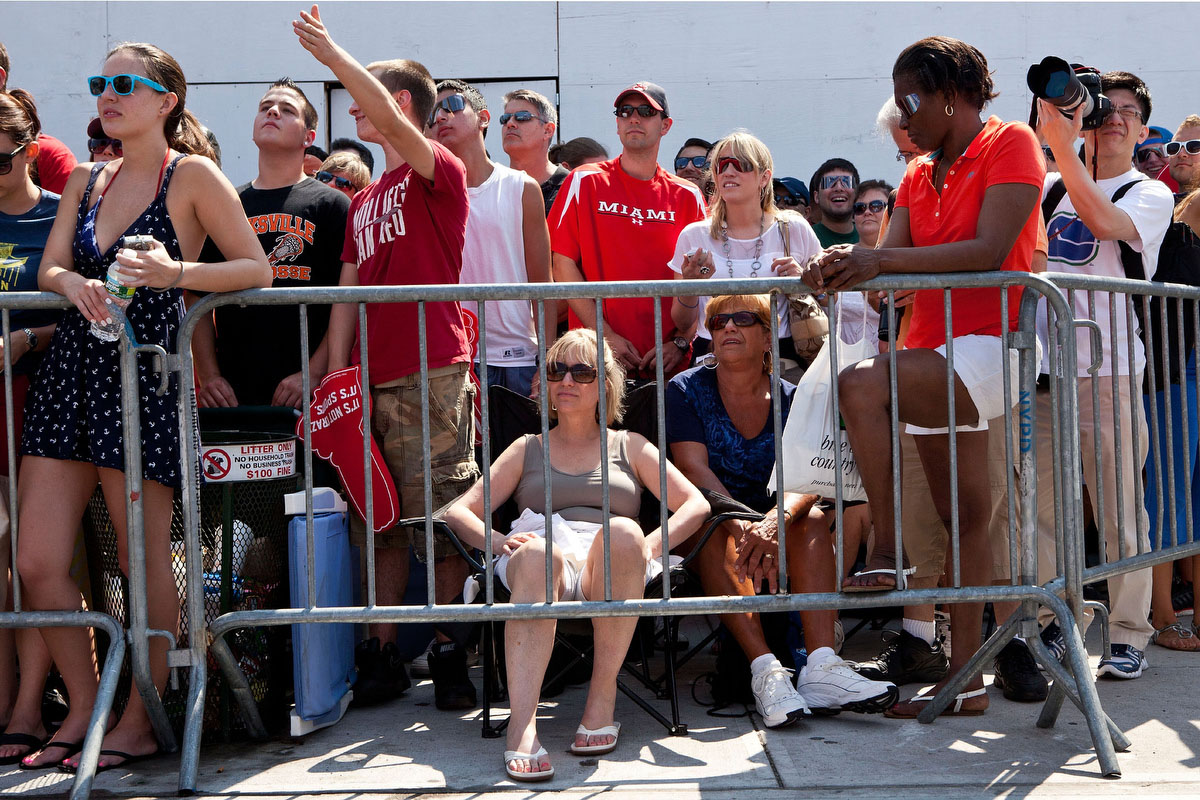 People wait to watch the Nathan's Famous International Hot Dog Eating Contest at Coney Island in the Brooklyn borough of New York City.(Andrew Burton/Getty Images)