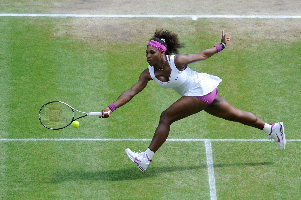 Serena Williams of the USA returns a shot during her Ladies' Singles semi final match against Victoria Azarenka of Belarus on day ten of the Wimbledon Lawn Tennis Championships at the All England Lawn Tennis and Croquet Club in London, England. (Gerry Penny/Getty Images)