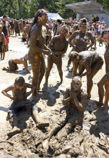 "Kids play in a giant lake of mud at the 25th annual ""Mud Day"" in Westland, Michigan. (Bill Pugliano/Getty Images)"