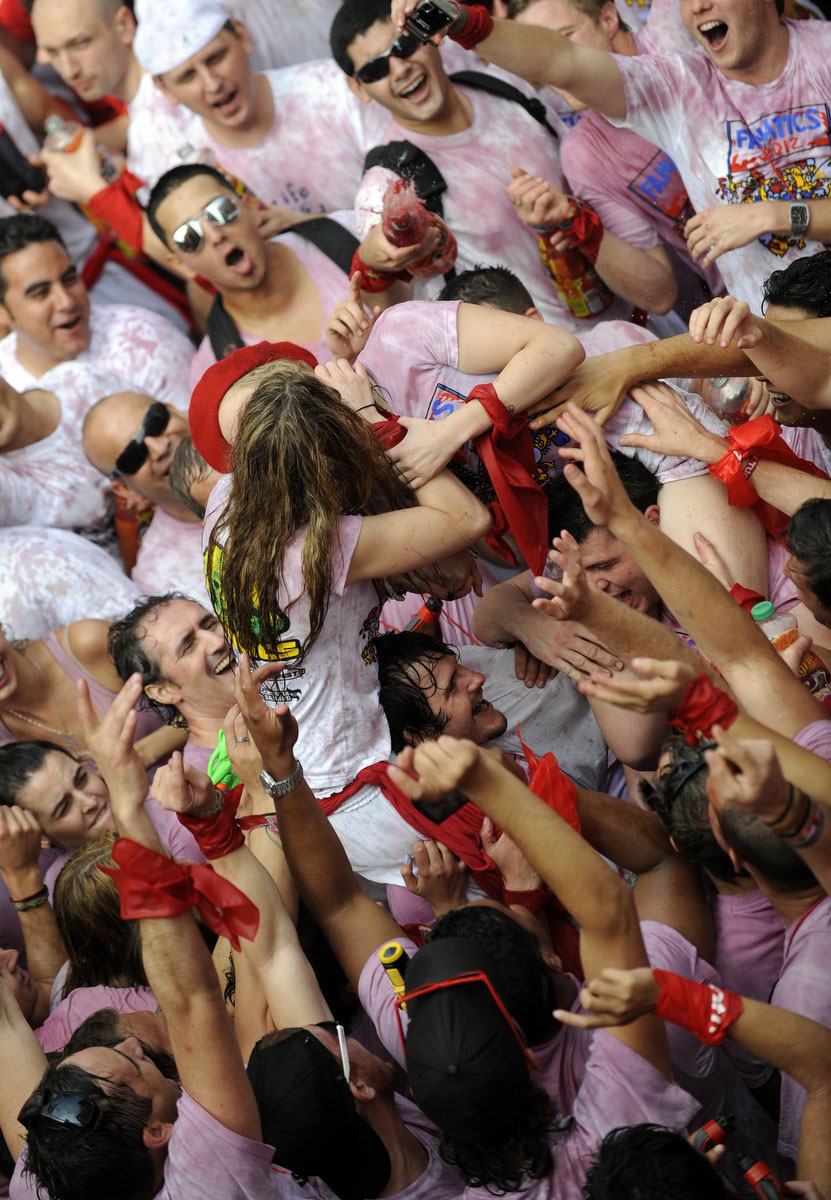 Two girls kiss each other as they celebrate during the 'Chupinazo' to mark the start at noon sharp of the San Fermin Festival on July 6, 2012 in front of the Town Hall of Pamplona, northern Spain. (Rafa Rivas/Getty Images)