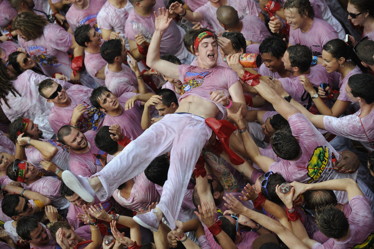 Participants celebrate during the 'Chupinazo' to mark the start at noon sharp of the San Fermin Festival on July 6, 2012 in front of the Town Hall of Pamplona, northern Spain. (Rafa Rivas/Getty Images)