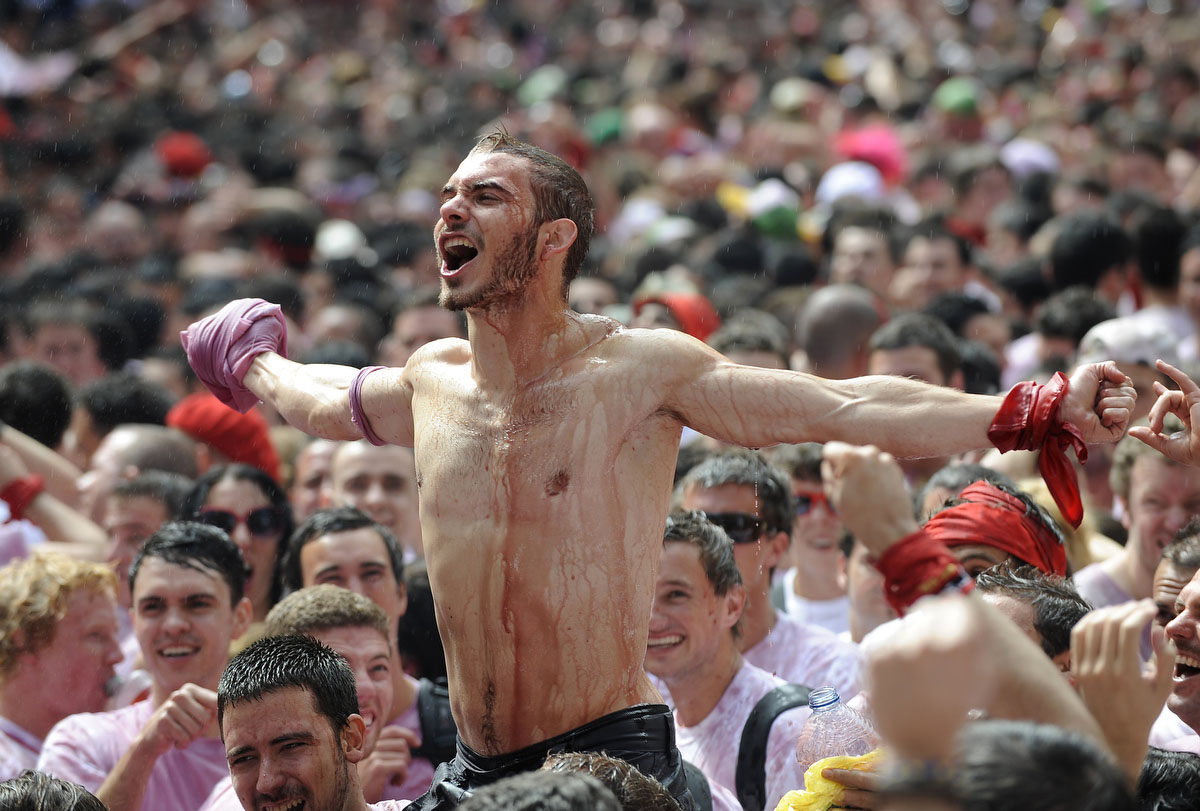 Participants celebrate during the 'Chupinazo' to mark the start at noon sharp of the San Fermin Festival on July 6, 2012 in front of the Town Hall of Pamplona, northern Spain. (Ander Gillenea/Getty Images)