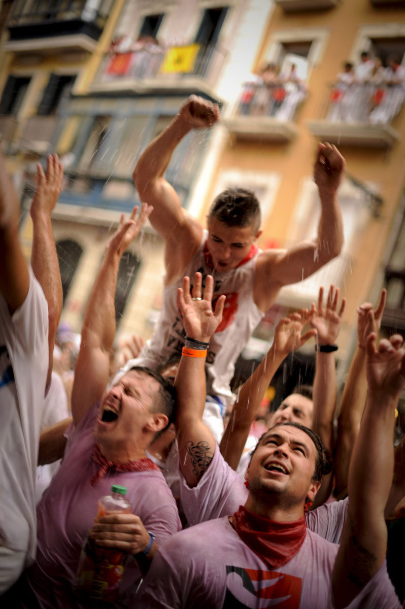 Participants celebrate during the 'Chupinazo' to mark the start at noon sharp of the San Fermin Festival on July 6, 2012 in front of the Town Hall of Pamplona, northern Spain. (Pedro Armestre/Getty Images)