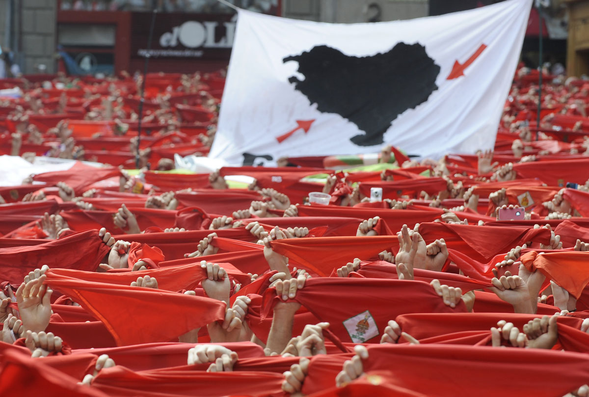 Participants hold red scarves during the 'Chupinazo' to mark the start at noon sharp of the San Fermin Festival on July 6, 2012 in front of the Town Hall of Pamplona, northern Spain. (Ander Gillenea/Getty Images)
