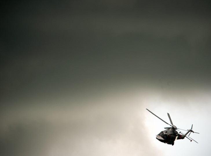 An Agusta Westland helicopter flies through a gap in the clouds during a flying display at the third day at the Farnborough International Airshow in Hampshire, southern England. Thousands of industry executives from the worlds of aerospace and defense are gathered at the biennial show. (Adrian Dennis/GettyImages)