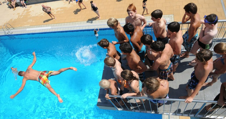 Children line up to take a dive in a swimming pool in the southern German town of Denzlingen. Temperatures in Germany are forecast to remain high during the next few days with occasional thunderstorms on the weekend. (Patrick Seeger/AFP/Getty Images)