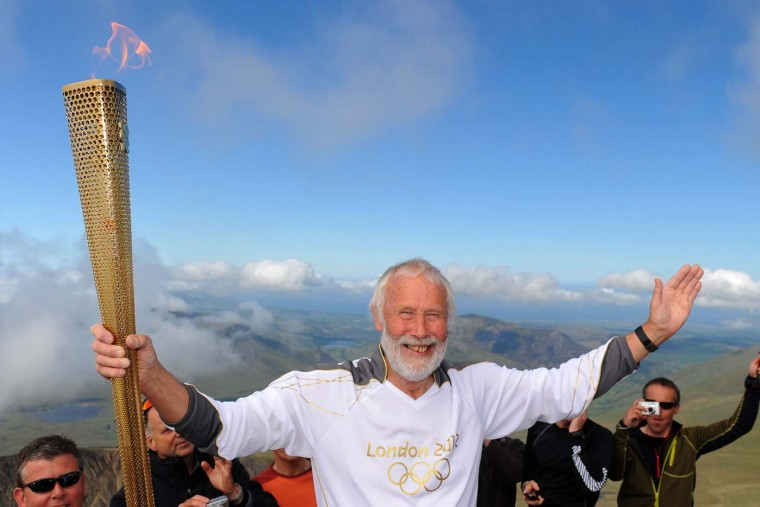MAY 29: Legendary mountaineer Sir Chris Bonington, 77, holds the Olympic torch on the summit of Mount Snowdon in Llanberis, United Kingdom. (LOCOG via Getty Images) ORG XMIT: 145041417