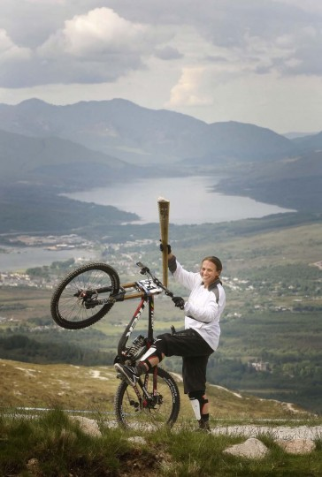 JUNE 9: Mountain Biker Tracy Moseley carries the Olympic Flame on the Nevis Range during Day 22 of the London 2012 Olympic Torch Relay in Scotland, United Kingdom. (LOCOG via Getty Images)
