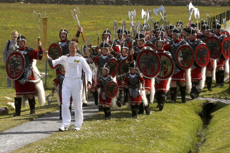 JUNE 10: Torchbearer #039 Matthew Cox carries the Olympic Flame during Day 23 of the London 2012 Olympic Torch Relay in Lerwick, Scotland. (LOCOG via Getty Images)