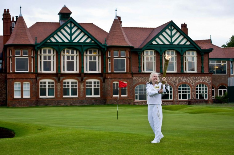 JUNE 23: Torchbearer Alice Kelly holds the Olympic Flame at Royal Lytham and St. Anne's Golf Club on Day 36 of the London 2012 Olympic Torch Relay. (LOCOG via Getty Images)