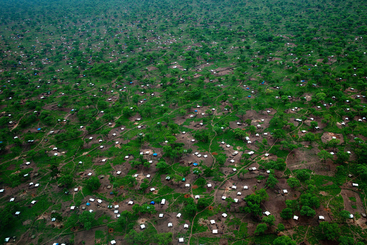 JUNE 29: White tents scatter the landscape as seen from this aerial photo of the Yida refugee camp along the border with North Sudan June 29, 2012 in Yida, South Sudan. Yida refugee camp has swollen to nearly 60,000, as the refugees flee from South Kordofan in North Sudan. The international aid community is struggling to provide basic assistance to the growing population, most have arrived with only the clothes they are wearing. Many new arrivals walked from 5 days up to 2 weeks or more to reach the camp. (Paula Bronstein/Getty Images)