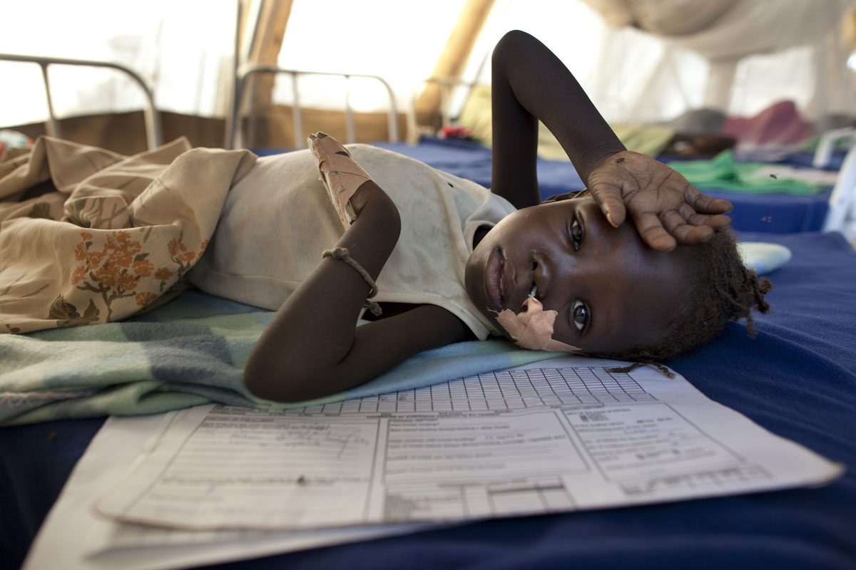 JUNE 29: Rebecca,4 years, lays in the inpatient ward at a malnutrition and feeding center at the Yida refugee camp along the border with North Sudan June 29, 2012 in Yida, South Sudan. Yida refugee camp has swollen to nearly 60,000, as the refugees flee from South Kordofan in North Sudan. The rainy season has increased the numbers of sick children suffering from Diarrhea and severe malnutrition as the international aid community struggles to provide basic assistance to the growing population, most have arrived with only the clothes they are wearing. Many new arrivals walked from 5 days up to 2 weeks or more to reach the camp. (Paula Bronstein/Getty Images)