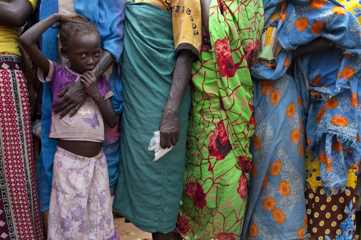 JUNE 30: New arrivals wait in long lines to register with UNHCR at the Yida refugee camp along the border with North Sudan June 30, 2012 in Yida, South Sudan. Water has been a precious resource that aid agencies have struggled with. Yida refugee camp has swollen to nearly 60,000, as the refugees flee from South Kordofan in North Sudan with new arrivals at 300-600 a day. The rainy season has increased the numbers of sick children suffering from Diarrhea and severe malnutrition as the international aid community struggles to provide basic assistance to the growing population, most have arrived with only the clothes they are wearing. Many new arrivals walked from 5 days up to 2 weeks or more to reach the camp. (Paula Bronstein/Getty Images)