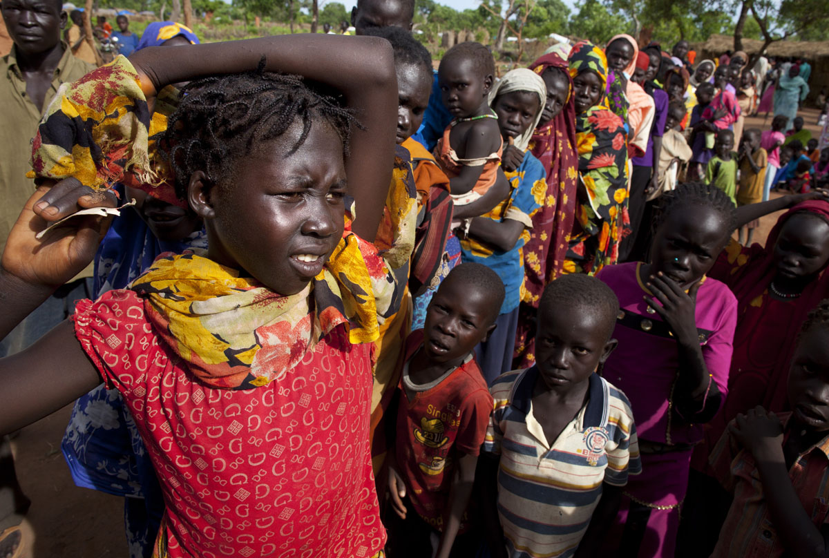 JULY 3: New arrivals wait in long lines for hours to register with UNHCR at the Yida refugee camp along the border with North Sudan July 3, 2012 in Yida, South Sudan. Yida refugee camp grows by each day and now has swollen to well over 60,000, as the refugees flee from South Kordofan in North Sudan. The numbers of refugees arriving from north Sudan vary from 500 to 1,000 a day. Water has been a precious resource that aid agencies have struggled with. The rainy season has increased the numbers of sick children suffering from Diarrhea and severe malnutrition as the international aid community struggles to provide basic assistance to the growing population, most have arrived with only the clothes they are wearing. Many new arrivals walked from 5 days up to 2 weeks or more to reach the camp. (Paula Bronstein/Getty Images)