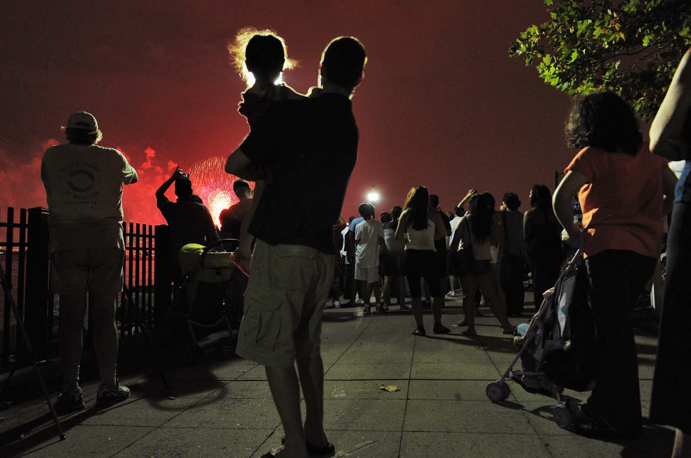 WEST NEW YORK, NJ - JULY 04: Spectators watch the 2012 Macy's Fireworks Spectacular over the Hudson River from Port Imperial on July 4, 2012 in West New York, New Jersey. (Michael Loccisano/Getty Images)