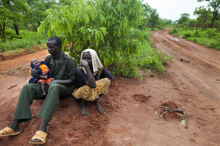 JULY 6: A Sudanese family rests along the border road, they have been walking for the past 3 days from North Sudan July 6, 2012 along the border road, South Sudan. Many refugees have been walking for 4 to 5 days to get to Yida refugee camp from the Nuba mountain region where they have no food and are fleeing the on-going conflict. Yida refugee camp has swollen to nearly 60,000, as the refugees flee from South Kordofan in North Sudan with new arrivals at 300-600 a day. The rainy season has increased the numbers of sick children suffering from Diarrhea and severe malnutrition as the international aid community struggles to provide basic assistance to the growing population, most have arrived with only the clothes they are wearing. Many new arrivals walked from 5 days up to 2 weeks or more to reach the camp. (Paula Bronstein/Getty Images)