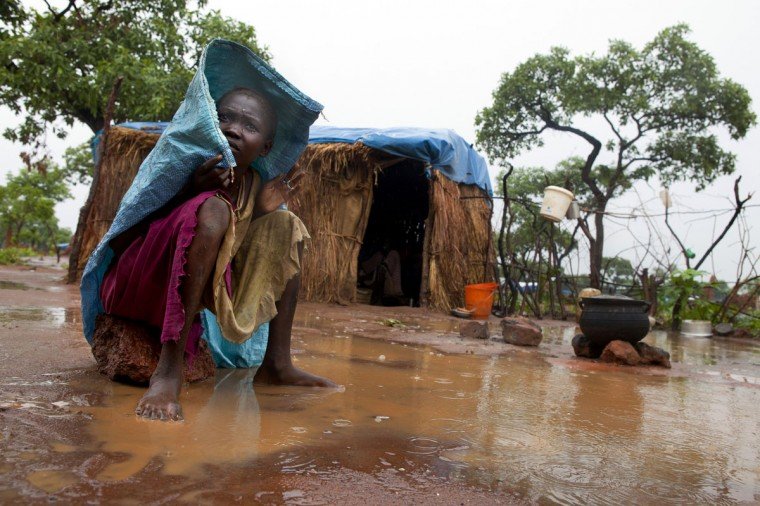 JULY 5: A Sudanese woman sits outside her hut on a rainy afternoon at the Yida refugee camp along the border with North Sudan July 5, 2012 in Yida, South Sudan. Yida refugee camp grows each day and now has swollen to 64,317, as the refugees continue to flee from South Kordofan in North Sudan. The numbers of refugees arriving from North Sudan vary from 500 to 1,000 a day. Many new arrivals walked from 3 to 5 days to reach the camp without food. The rainy season has increased the numbers suffering from diarrhea, severe malnutrition and malaria. Even with refugees having food, there are sanitation issues causing the increased illness with the field hospitals saying that 95% of all patients are under the age of five. (Paula Bronstein/Getty Images)
