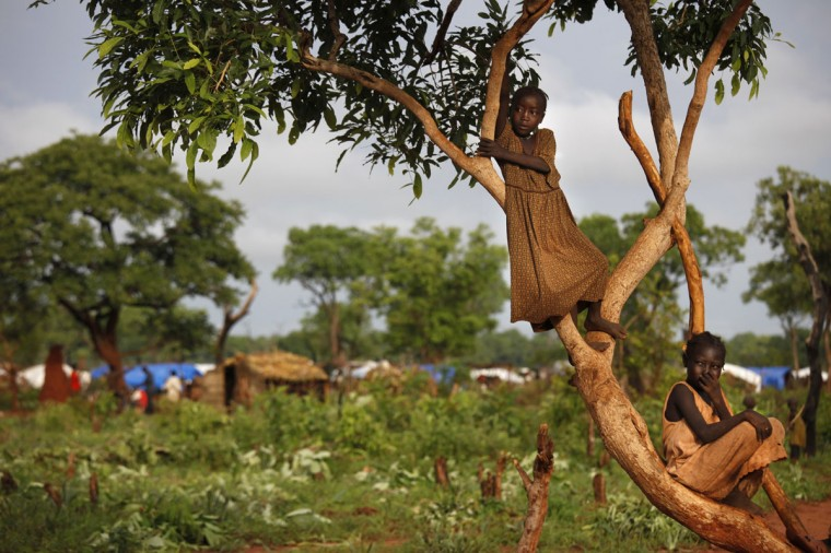 JULY 6: Sudanese girls hang out on a tree at the Yida refugee camp July 6, 2012 in Yida, South Sudan. Yida refugee camp grows each day and now has swollen to 64,317, as the refugees continue to flee from South Kordofan in North Sudan. The numbers of refugees arriving from North Sudan vary from 500 to 1,000 a day. Many new arrivals have walked from 3 to 5 days to reach the camp, most without food. The rainy season has increased the numbers suffering from diarrhea, severe malnutrition and malaria with sanitation issues causing the increased illness. Field hospitals say that 95% of all patients are under the age of five. (Paula Bronstein/Getty Images)