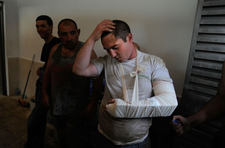 An injured Aloitadore (fighter) reacts during the Rapa das Bestas on July 7, 2012 in Sabucedo, Spain. (Denis Doyle/Getty Images)