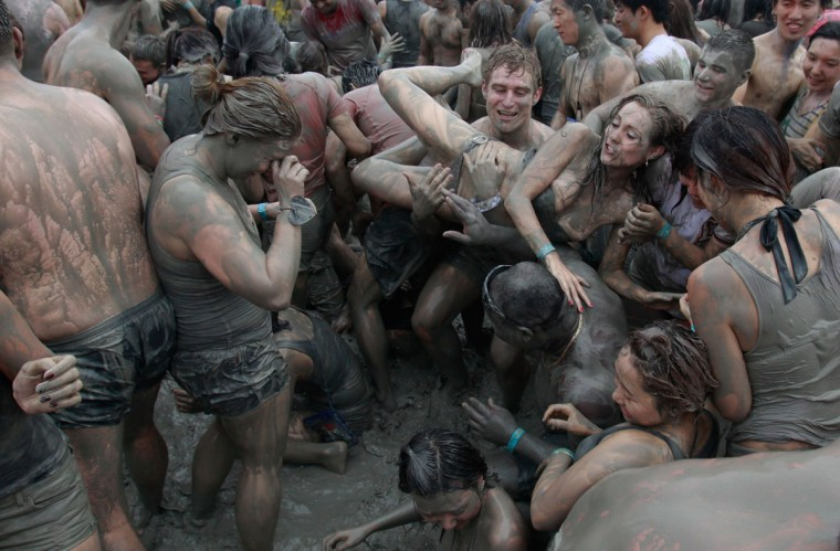 Festival goers wrestle in the mud during the 15th Annual Boryeong Mud Festival at Daecheon Beach on July 14, 2012 in Boryeong, South Korea. (Chung Sung-Jun/Getty Images)
