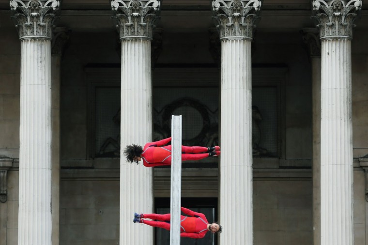Dancers perform a routine in front of the National Gallery in Trafalgar Square as part of the 'One Extraordinary Day' performances in London, England. The dancers are part of American choreographer Elizabeth Streb's 'Extreem Action' dance group which will perform around London for one day only and form part of the Cultural Olympiad. (Dan Kitwood/Getty Images)