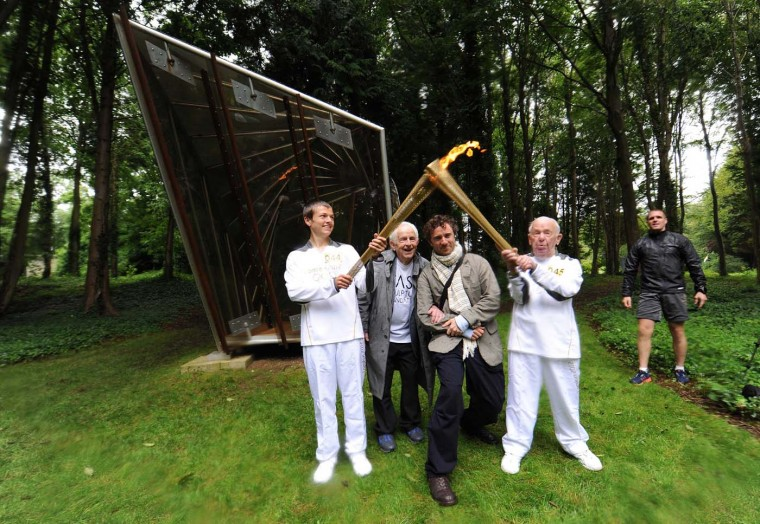 CHICHESTER, UNITED KINGDOM - JULY 16: Ryan Hoddjarbis, Wilfred Cass, Thomas Heatherwick and Paul Zetter pose for photographs during the Olympic Torch Procession at Cass Sculpture Foundation on July 16, 2012 in Chichester, England. (Stuart Wilson/Getty Images For Cass Sculpture Foundation)