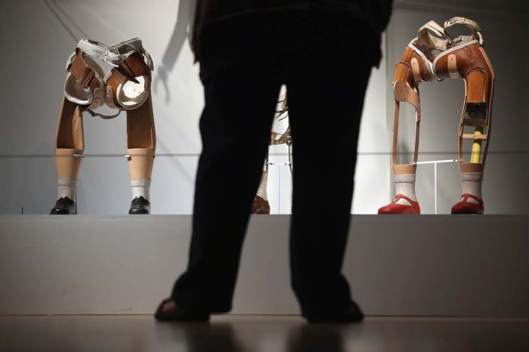 Prosthetic legs are exhibited at the Wellcome Trust's new exhibition 'Superhuman' in London, England. The exhibit makes up part of the Wellcome Collection's new summer exhibition, 'Superhuman', which focuses on the many ways mankind have sought to improve, adapt or enhance their body's performance, and opens to the public from July 19 to October 16, 2012. (Dan Kitwood/Getty Images)