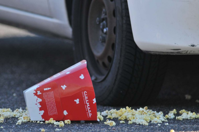 """A popcorn box lies on the ground outside Century 16 movie theatre where a gunmen attacked movie goers during an early morning screening of the new Batman movie """"The Dark Knight Rises"""" July 20, 2012 in Aurora. (Thomas Cooper/Getty Images)"""