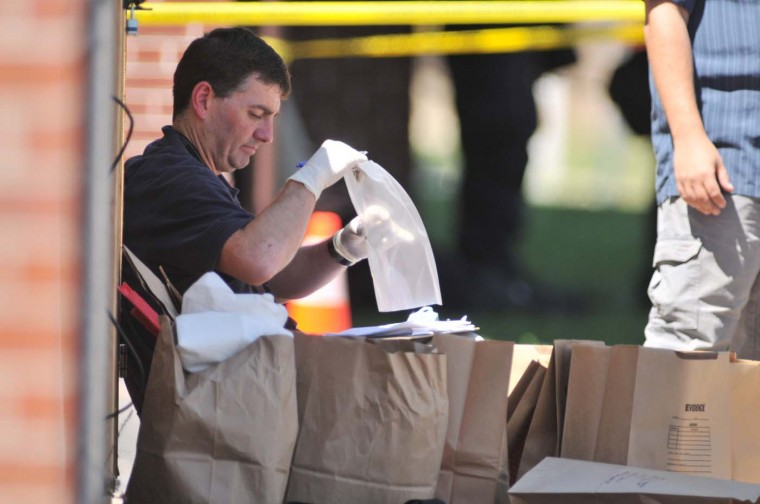 Investigators work on evidence near the apartment of of James Holmes, the suspect of a shooting in a movie theater July 20, 2012 in Aurora, outside of Denver, Colorado. (Thomas Cooper/Getty Images)