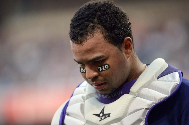 Catcher Wilin Rosario #20 of the Colorado Rockies looks on as he leaves the game with an injury against the San Diego Padres during their MLB game in San Diego, California. Players of the Colorodo Rockies are wearing 7-20 eye black stickers in mourning over the Aurora, Colorado shootings. (Donald Miralle/Getty Images)