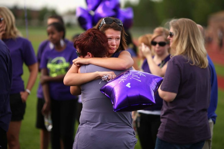 Family, friends and former classmates of movie theater shooting victim AJ Boik gather for a memorial service at Gateway High School in Aurora, Colorado. Boik and his girlfriend were at the midnight showing of 'The Dark Knight Rises' when a guman killed Boik and 11 other people. Chip Somodevilla/Getty Images)