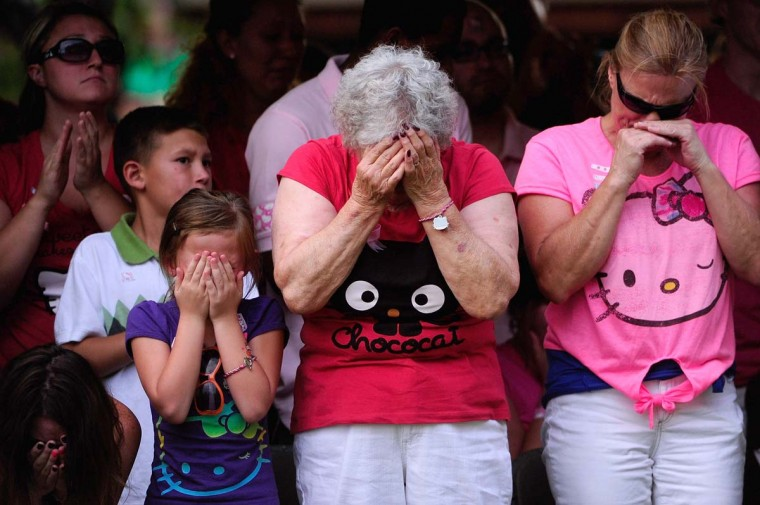Family members react as the names of the 12 victims of the mass shooting at Century 16 movie theater are read aloud during a prayer vigil at the Aurora Municipal Center in Aurora, Colorado. (Aaron Ontiveroz/Denver Post via Getty Images)