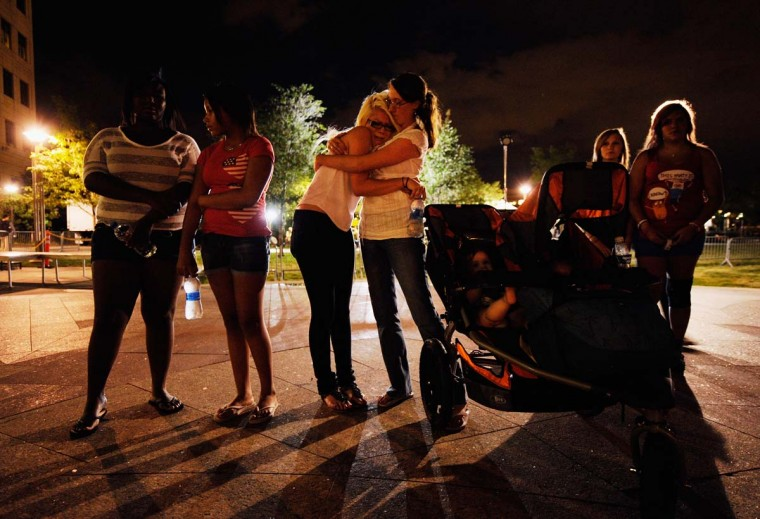 Mourners gather at the fountain of Aurora Municipal Center after a prayer vigil for the 12 victims of Friday's mass shooting at the Century 16 movie theater in Aurora, Colorado. (Kevork Djansezian/Getty Images)