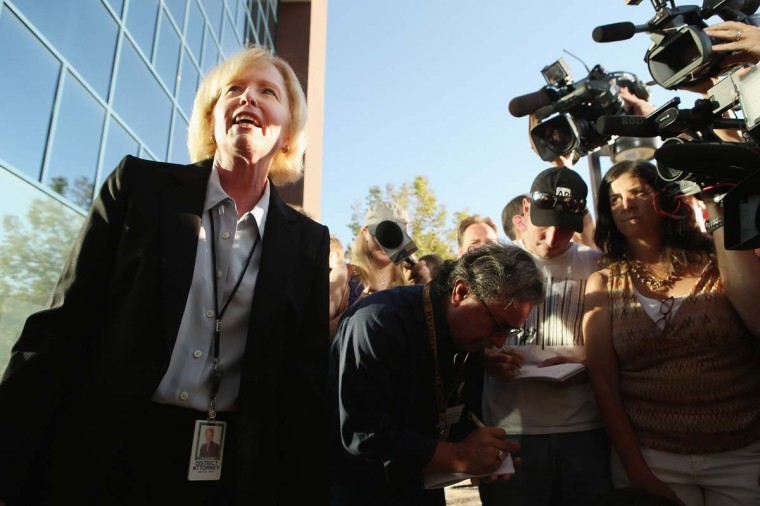 Arapahoe County District Attorney Carol Chambers talks to members of the news media before heading into the Arapahoe County Courthouse in Centennial, Colorado. Chambers said the prosecutor's office would consult with family members when deciding whether or not to pursuit the death penalty for James Holmes, 24, who is accused of killing 12 people and injuring 58 in a shooting spree Friday during a screening of 'The Dark Knight Rises.' (Chip Somodevilla/Getty Images)