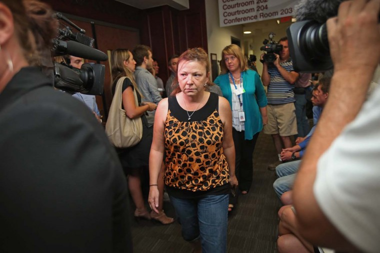 Family members of the victims of last Friday's movie theater mass shooting arrive at the Arapahoe County Courthouse for James Holmes' first court appearance July 23, 2012 in Centennial, Colorado. (Chip Somodevilla/Getty Images)