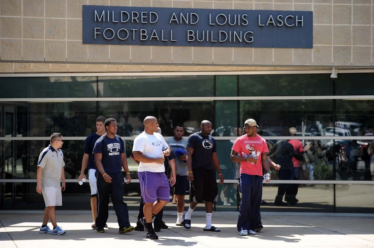 Penn State football players leave the Mildred and Louis Lasch Football Building following a team meeting soon after the NCAA announced Sanctions on July 23, 2012 in State College, Pennsylvania. As an outcome of the university's mishandling of the allegations of child-sexual abuse by former coach Jerry Sandusky, Penn State was fined $60 million, stripped of all its football wins from 1998 through 2011, barred from postseason games for four years, and lost 20 total scholarships annually for four seasons. (Patrick Smith/Getty Images)