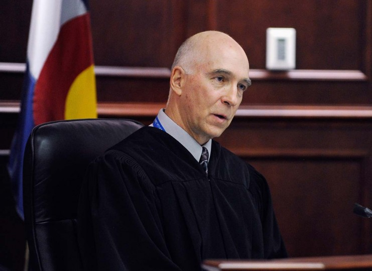 Chief Judge William B. Sylvester presides over the accused movie theater shooter James Holmes' first court appearance at the Arapahoe County in Centennial, Colorado.(RJ Sangosti-Pool/Getty Images)