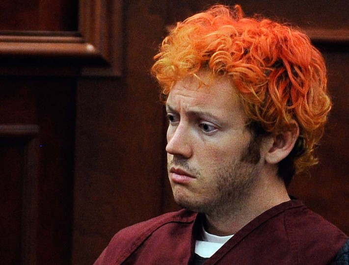 """Accused movie theater shooter James Holmes makes his first court appearance at the Arapahoe County in Centennial, Colorado. According to police, Holmes killed 12 people and injured 58 others during a shooting rampage at an opening night screening of """"The Dark Knight Rises"""" July 20, in Aurora, Colorado. (RJ Sangosti-Pool/Getty Images)"""