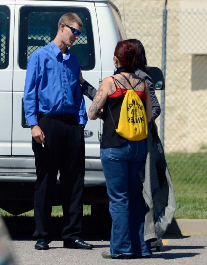 Ian Sullivan, father of six-year-old Veronica Moser, the youngest victim of the theater shooting, speaks with couple of women in parking lot in front of the Arapahoe County Detention Center after attending the first court hearing for alleged Century 16 movie theater shooter at the Arapahoe County Courthouse on in Centennial, Colorado. (Kevork Djansezian/Getty Images)