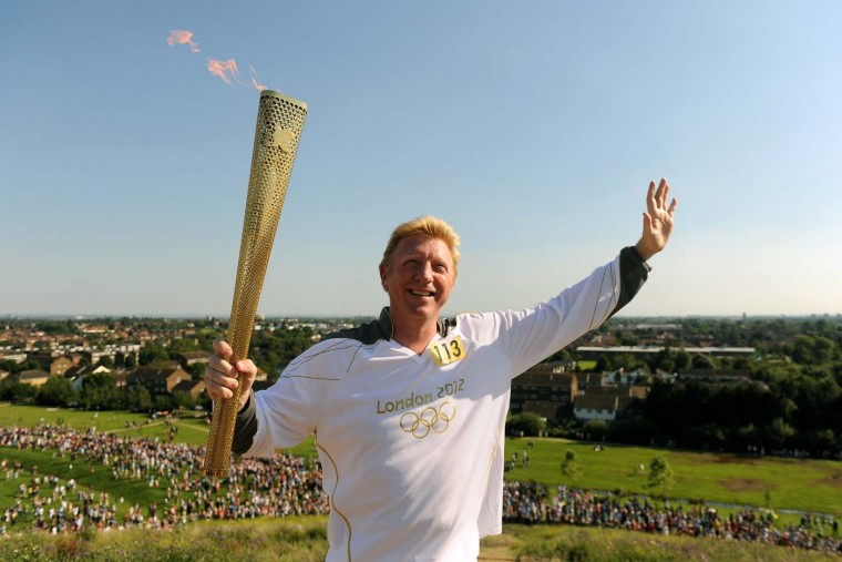 LONDON, UNITED KINGDOM - JULY 24: Torchbearer 113 Boris Becker carries the Olympic Flame on the Torch Relay leg through Ealing (London Borough) during day 67 of the Olympic Torch Relay on July 24, 2012 in London, England. (LOCOG/Getty Images)